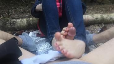 public footjob and socksjob in the woods