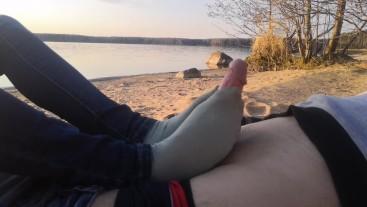 public footjob and socksjob on the beach