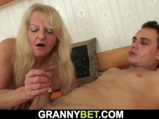 Very old blonde granny in stockings rides strangers cock