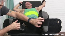 Feet tickled jock cannot stop laughing at his master
