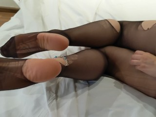 Ripping nylons on bed before going clubbing