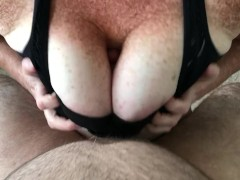 Redhead titfucks in a sports bra until it erupts between her freckled jugs