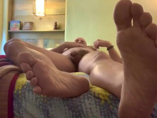 Big feet jock chilling naked in bed and...