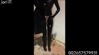 Latex Girl Wearing Vibrator and Walking Outside