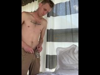 Skinny guy masturbating in a room full of windows