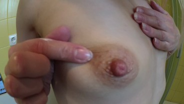 Playing with my small tits big nipples