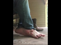 Husband shows off smelly feet