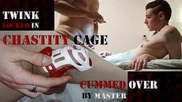 Twink Locked in Chastity Cage Cummed Over by Master