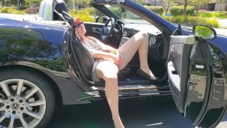 Redhead MILF fucking herself in public parking lot and trails