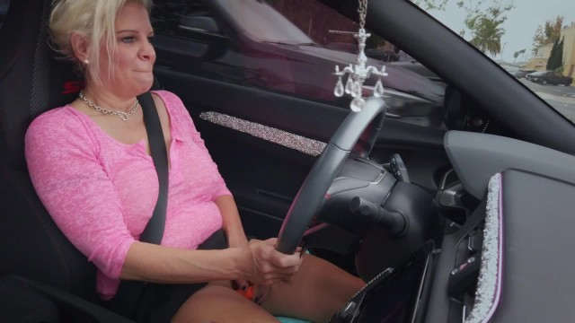 Driving car upskirt Toying my pussy while driving car in public with oblivious friend