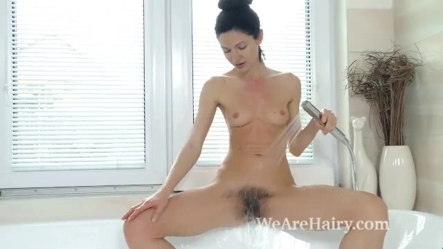 Efina strips naked before enjoying a nice shower