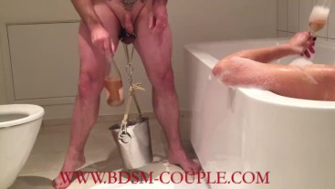 Miss M. relaxing in the tub - watching her slave's BALLS getting STRETCHED!