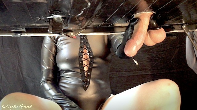 Ball bondage cock pic Mistress sensually milks big cock with leather gloves