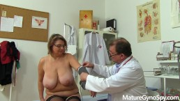 Chubby mature woman caught on hidden cam on her gyno exam by kinky doc