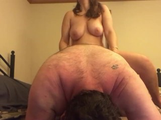 Fucking him with a strap on