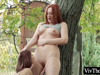 Lesbian redhead fingers a stranger...