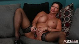 MILF in Lingerie Stocking spreads her legs to expose her swollen clit