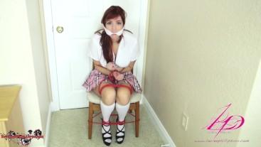 Redheaded School Girl Struggles in Rope Blondage For Fun