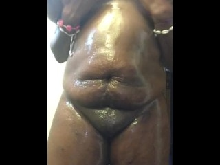 Oiled Up Ebony Plays With Her Tits