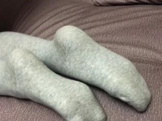 Show feet and gray knee socks stockings...