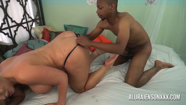 Alura Jenson jerks off a black cock with her feet 11