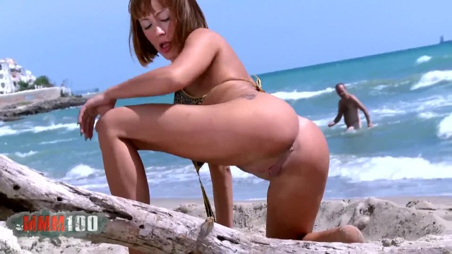 Nice with big boobs Mar Duran doing a strip by the sea