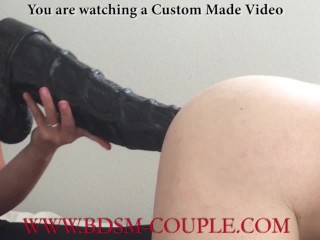 Warms up her slaves ass before he impales...