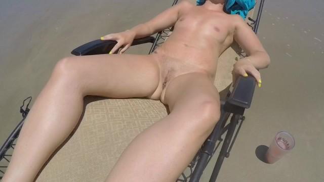 Janet jacksons nude sun bathing video Bubbles soaking up sun on north padre island beach.