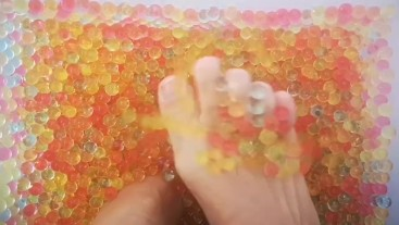 Feet playing in Orbeez