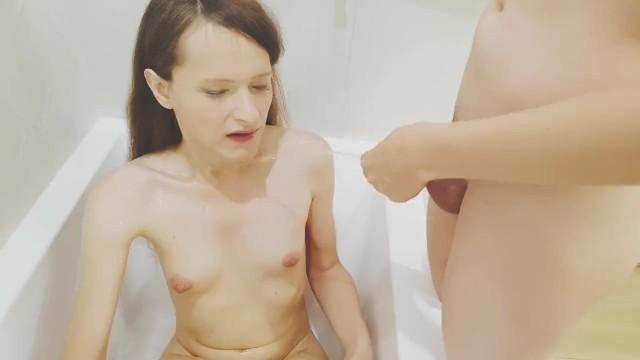 Pretty transgirl receive golden shower 2