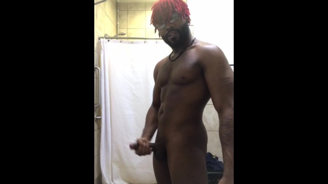 Guy stroking his cock Red haired black guy stroking his cock in the gym bathroom