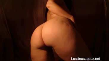 Luscious Lopez booty softly glowing in a dark room