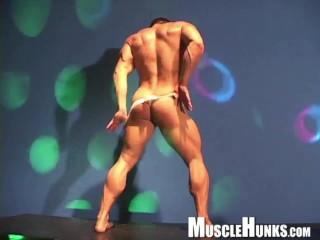Beefy bodybuilder as muscle stripper...