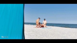 Sharing my girl with a stranger on the public beach. Threesome WetKelly.