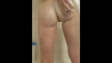Washing her tight pussy and ass