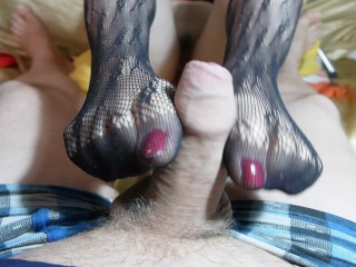 A handjob in black stockings with red nails...