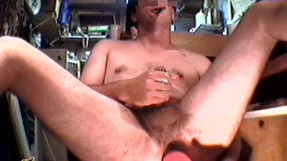 Smoking a cigar while fucking my ass with a toy bowling pin until I cum