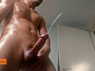 Hot muscular oiled guy works out,moans and shoots a HUGE cumshot (2 angles)
