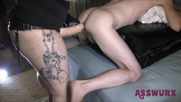 Tattooed Goddess works her boi's ass with a huge strapon and fists!