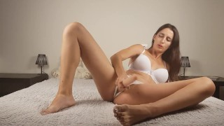 Girl sucks a very long dildo, fucks herself in the pussy and cums