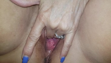 Australian Mature lady plays with and fingers her wet pussy
