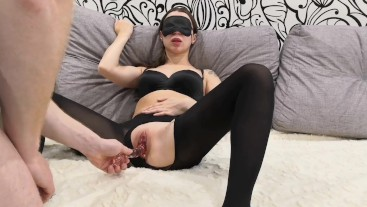 The guy fucks the girl in the black mask and cums on her