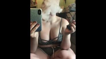 Hot milf smokes in a mirror