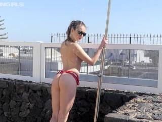 Young redhead in mesh bikini goes topless roof...