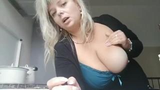 Women smoking at kitchen with naked big boobs