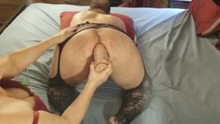 Crossdressing student getting rough fist with rubber gloves by his landlady