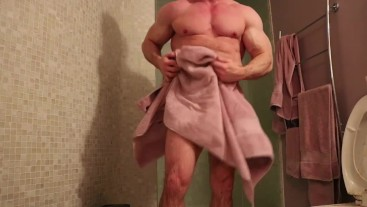 Fitness model dries himself off after shower