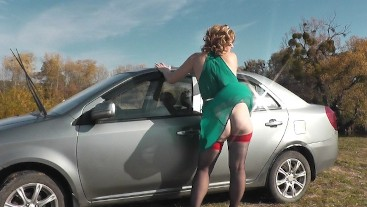 Sexy car wash . Woman Milf Under Dress Without Panties Outside Washes Car