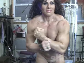 Muscular naked female bodybuilder shows off completely nude...