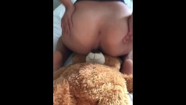 BABYSITTER PLAYS WITH TEDDYBEAR